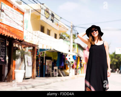 Woman standing in street - Stock Photo