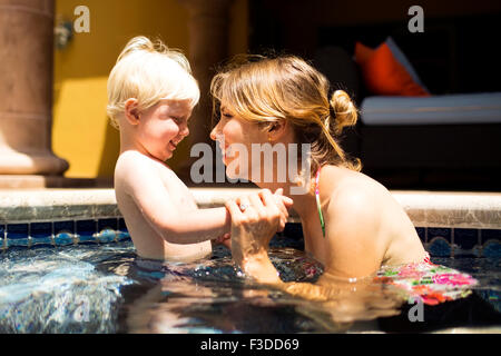 Mother with son (2-3) in swimming pool - Stock Photo