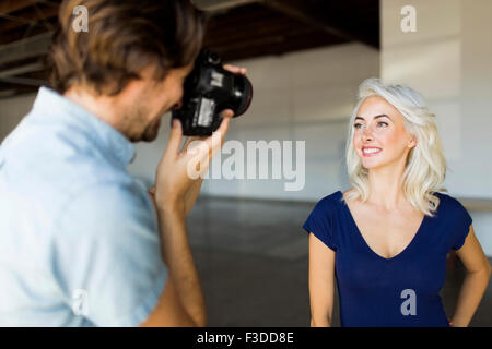 Man photographing woman - Stock Photo