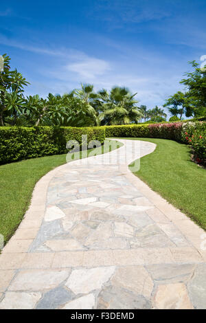 Curved stone footpath in a garden - Stock Photo