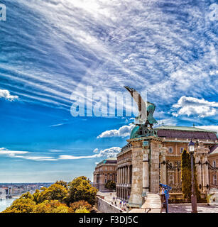 Statue of a Turul on the railing and main entrance of Buda Castle in Budapest, Hungary - Stock Photo