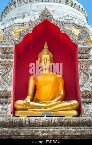 Golden Buddha inside chedi at Wat Buppharam, Chiang Mai - Stock Photo