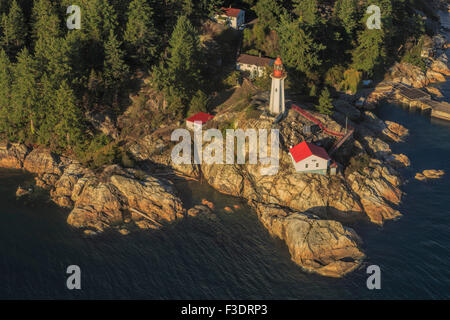 Aerial view from a seaplane on Point Atkinson Lighthouse and the scenic coastline of Vancouver, British Columbia, - Stock Photo