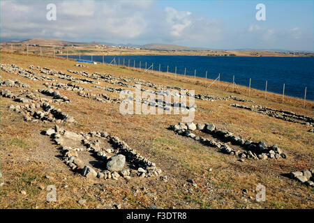 Russian-Cossack Civil War graveyard and crosses made by rocks mark the burial place of the fallen opposite Sharpi - Stock Photo