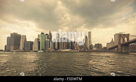 Retro toned stormy sky over Manhattan, NYC, USA.