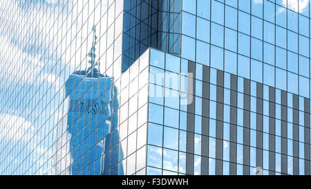 Reflection in modern office building windows, abstract background, NYC, USA.