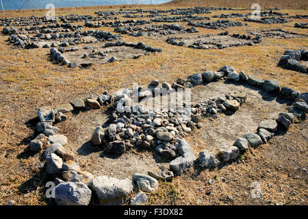 Cross-shaped burial mounds on burial area in the Russian-Cossack cemetery on cape Punta, Old Pedino village, Lemnos - Stock Photo