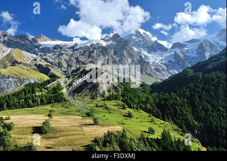 Alpine scenery with green hills and snowcapped mountains of village La Grave, French Alps, France, Valley of Romanche - Stock Photo