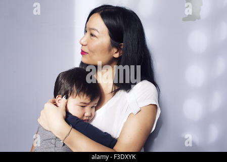 Mother embracing young son - Stock Photo