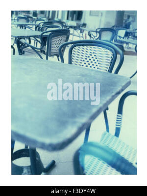 Tables and chairs of sidewalk cafe - Stock Photo