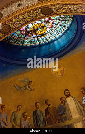 Mural and rose window in church - Stock Photo