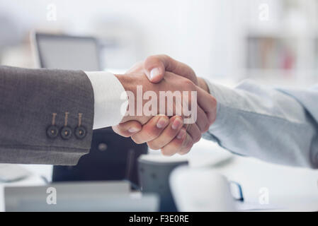 Business deal closed with handshake - Stock Photo