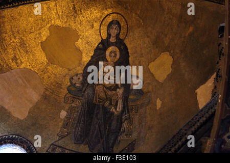 Virgin and The Child mosaic image in the apse of Hagia Sophia Museum in Istanbul. - Stock Photo