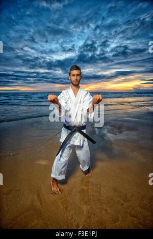 black belt karate mastar at sunset - Stock Photo