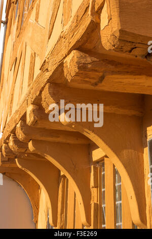 Medieval building, detail of the jettied front and oak corbels of Little Hall, a medieval half timbered hall house - Stock Photo
