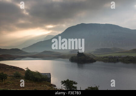 Dawn over Cregennan lakes and the distant Cader Idris mountain, Gwynedd, Snowdonia National Park, North Wales, UK - Stock Photo
