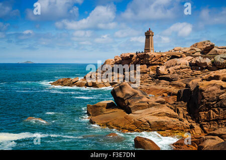 Phare de Mean Ruz lighthouse giant rocks at the Cote granit rose pink granite coast Ploumanac´h Perros Guirec French - Stock Photo