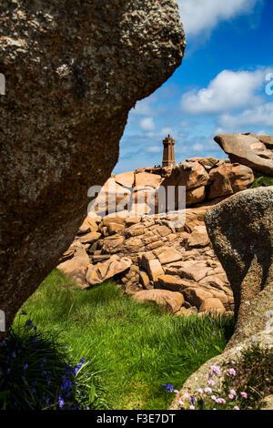 Phare de Mean Ruz lighthouse giant rocks at the Cote granit rose pink granite coast Ploumanac´h Perros Guirec France - Stock Photo
