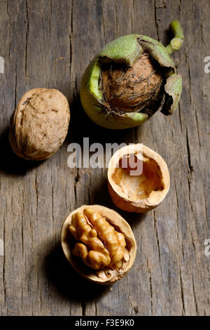 Walnuts on rustic old wooden table - Stock Photo