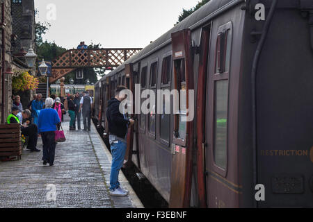 Passengers on Platform with Carriages - Stock Photo