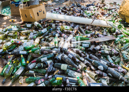Pile of dusty empty beer and wine bottles at Katundu creative trade workshop, Likoma Island, Lake Malawi, Malawi, - Stock Photo