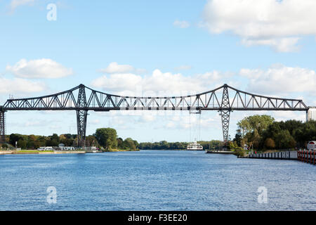 Rendsburg High Bridge with its suspension ferry across the Kiel Canal - Stock Photo