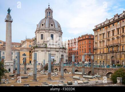 Trajan Column and Santa Maria Di Loreto church in Rome, Italy - Stock Photo