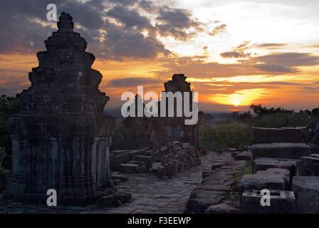 Phnom Bakheng Temple. Sunrise. Phnom Bakheng is located 1,30 meters (4,265 feet) north of Angkor Wat and 400 meters - Stock Photo