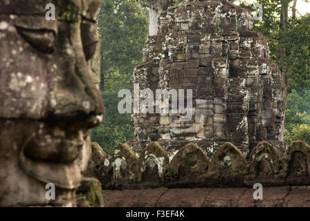 The faces of the Bayon temple. Angkor Thom. Angkor Thom was built as a square, the sides of which run exactly north - Stock Photo