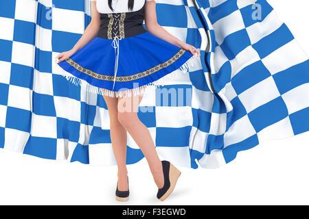 Composite image of oktoberfest girl spreading her skirt - Stock Photo