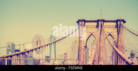 Vintage filtered panoramic picture of Brooklyn Bridge in New York City, USA - Stock Photo