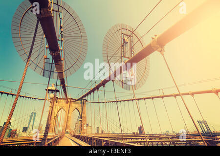 Vintage toned fisheye lens picture of Brooklyn Bridge in New York City, USA. - Stock Photo