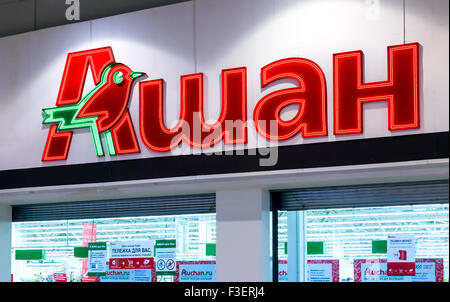 Auchan trade mark. French distribution network Auchan united more than 1300 shops - Stock Photo