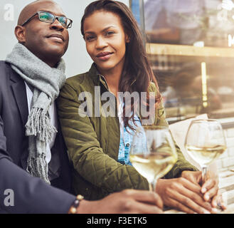 Afro american couple dating, woman looking straight at camera - Stock Photo