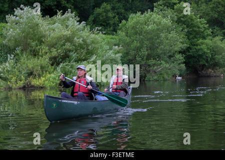50 year old couple paddling kayak canoe on River Wye near Symonds Yat, Herefordshire, England, UK - Stock Photo