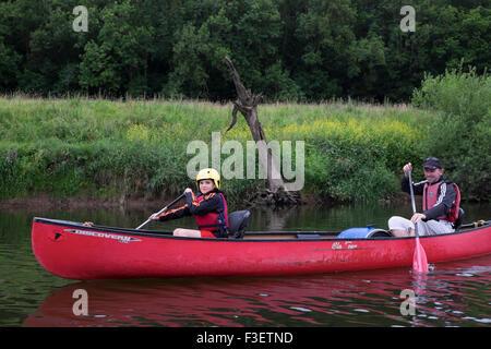 Father with 8 year old son paddling kayak canoe on River Wye near Symonds Yat, Herefordshire, England, UK - Stock Photo
