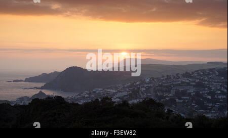A spectacular sunrise viewed from Torrs Park looking over the North Devon town of Ilfracombe - Stock Photo