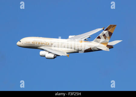 London Heathrow, United Kingdom - August 28, 2015: An Etihad Airways Airbus A380 with the registration A6-APC taking - Stock Photo