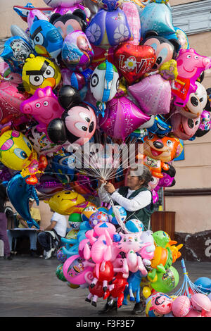 Lima, Peru - September 5, 2015: An old lady selling balloons in the city center on a Saturday afternoon. - Stock Photo