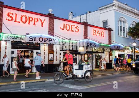 Key West Florida Keys Old Town Duval Street night nightlife Sloppy Joe's Bar front entrance pedicab - Stock Photo
