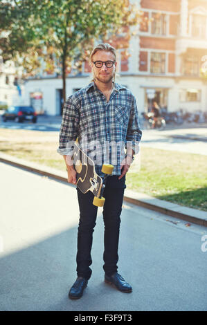 Hipster style portrait of young man. Stylish man with long blond hair - Stock Photo