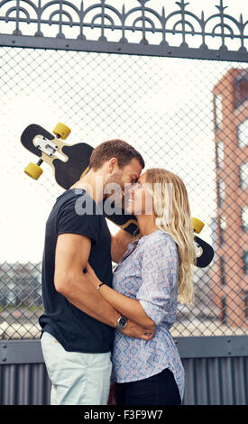 Couple missed each other and meet in city environment - Stock Photo