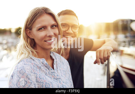Couple Sitting on their Boat, Smiling at Camera - Stock Photo