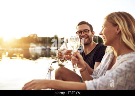 Happy Couple Toasting Glasses on a Summer Evening - Stock Photo