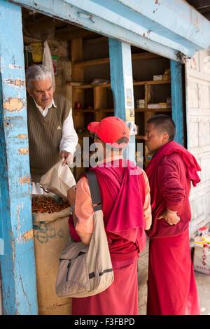 India, Jammu & Kashmir, Ladakh, Leh, daily life, two monks shopping in bazaar food shop - Stock Photo