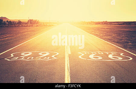 Retro old film style sunset over Route 66, California, USA. - Stock Photo