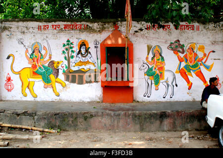 Painting of Indian god on wall - Stock Photo