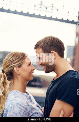 White Loving Couple In The City, Looking In Each Others Eyes - Stock Photo