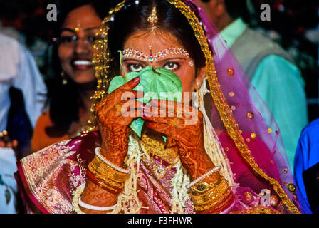 A romantic moment before bride meeting the bridegroom in the traditional Bengali marriage ; India - Stock Photo