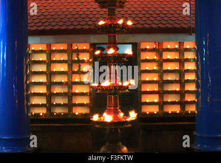 Oil lamps in temple ; Ernakulum ; Kerala ; India - das 149088 - Stock Photo